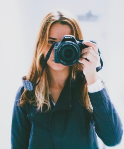 Woman taking picture while being photographed