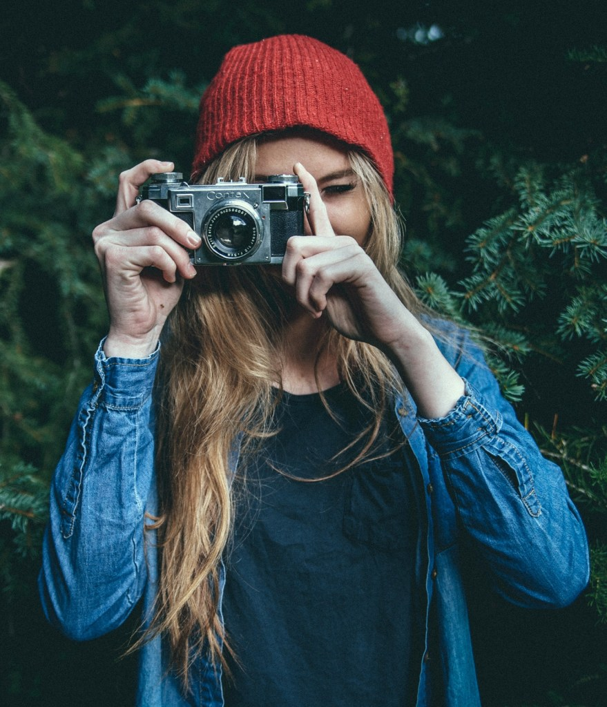 Woman in beanie taking picture