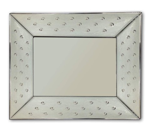 Decorative glass wall mirror with beveled glass edges and the appearance of a frameless mirror.