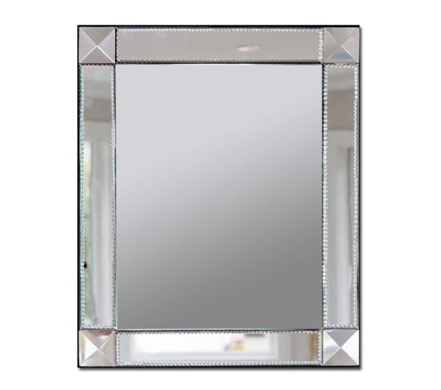 Slightly rectangular beveled glass wall mirror with detailed mirrored glass frame.
