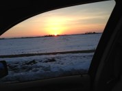 a beautiful sunset seen while driving