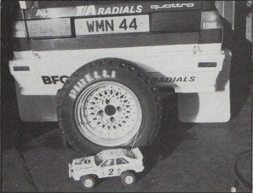 Tamiya Audi Quattro sitting beside real Audi Quattro rally car, RAC Rally 1984
