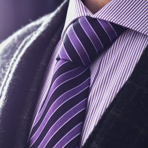 Silk purple necktie with black stripes and white tones