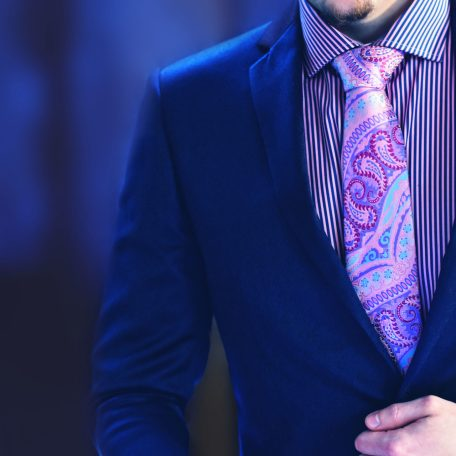 Luxurious silk pink paisley necktie in blue blazer with pink and blue pocket square