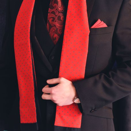 Gentlemen's elegant formal suit scarf of red color