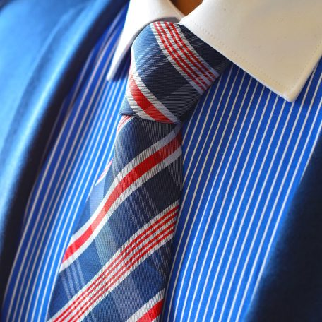 Red and blue striped tie with white tones along the striped edges