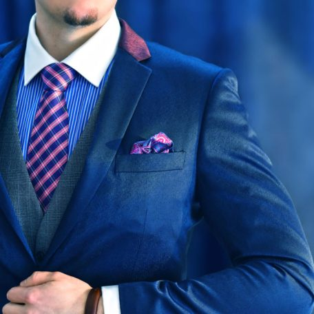 Luxurious silk necktie of blue and pink color
