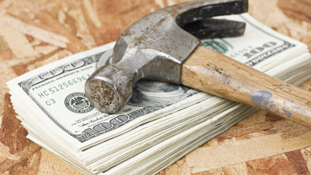 Hammer on Stack of Money