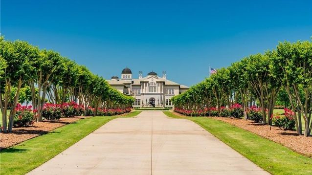 The Kenny King mansion sits at the end of an 1,100-foot-long driveway.