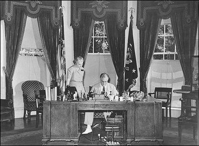 President Franklin Roosevelt meets with Marguerite Le Hand, his personal secretary.