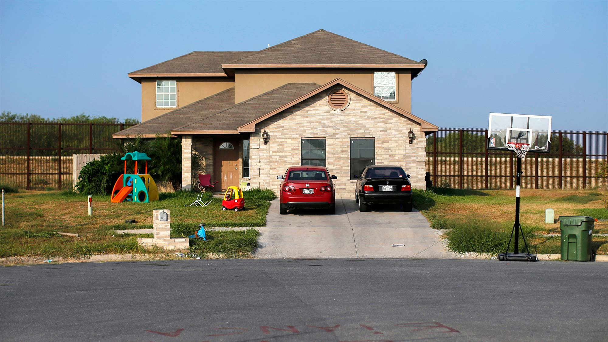 Home along the border fence in Brownsville, TX