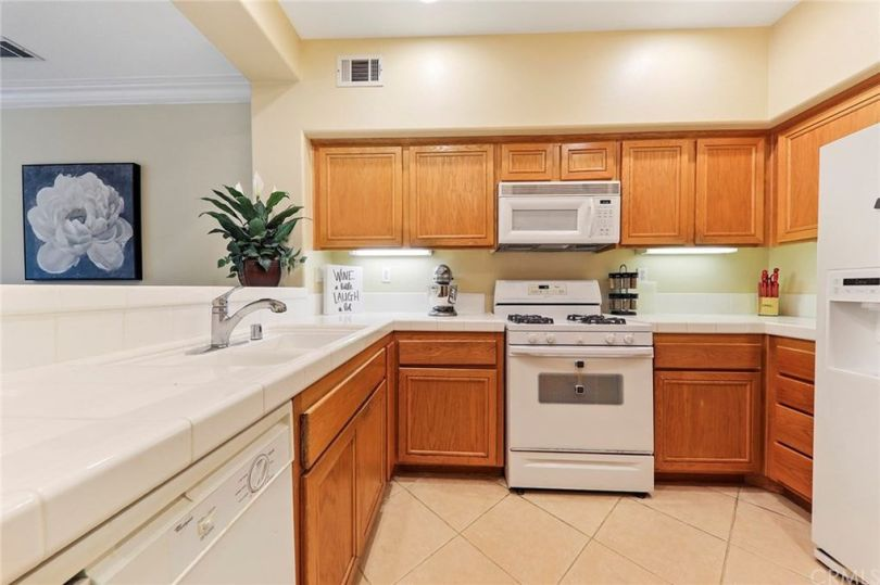 This is one of the many basic, outdated kitchens I saw. Kitchens should feel inviting, but I thought this one just felt boring.