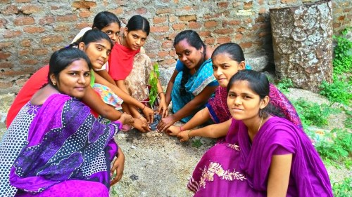 Students planting saplings in Kalleda