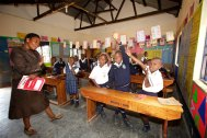"""Even I had a hard time leaving this engaging teachers class, when a child got an answer correct or did something worthy of praise she would say with a thick Ugandan accent give him """"three flowers"""" with both hands raised imitating the shape of flowers accompanied with a wonderful swooshing sound!"""
