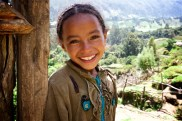 This beautiful smile was my reward for complimenting the lovely flowers on her dress. Precious girl in the mountains of Ethiopia
