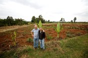 Joe and Rick in front of the Kidmia farm