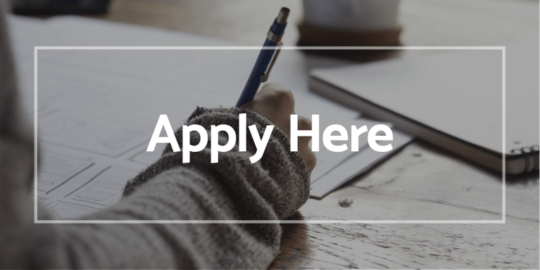 Apply Here - employee writing on paper