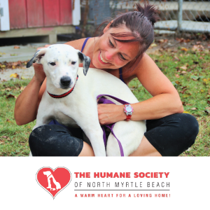 Advertisement featuring woman holding a dog for The Human Society of North Myrtle Beach