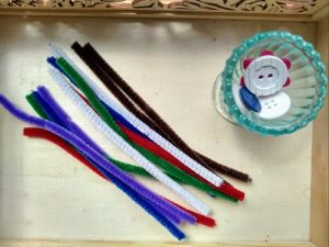 Pipe cleaners and buttons.