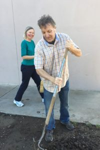 Jeff lends a hand with shoveling dirt