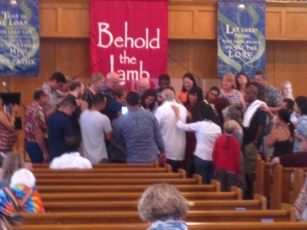 Praying for the newly betrothed couple.
