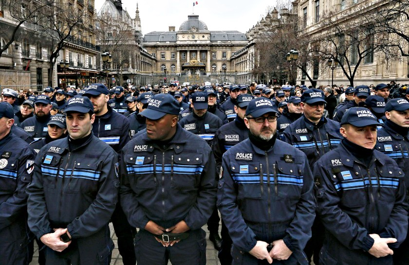 French municipal Police officers react as they attend a national