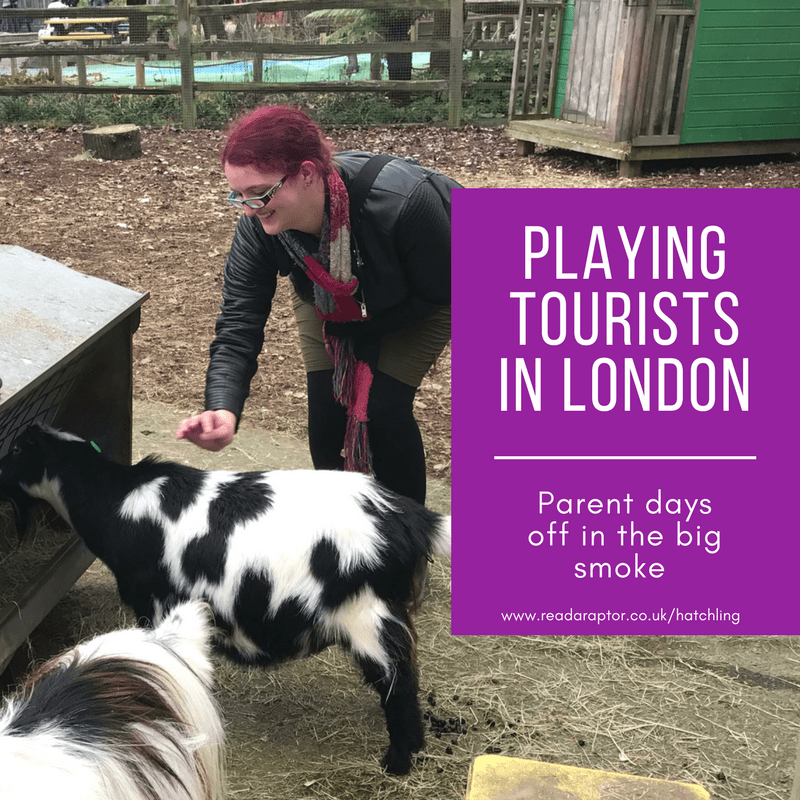 Woman petting a goat at London Zoo. Playing tourists in London during our parents' days off