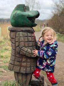Spike cuddling Toad from Wind in the Willows statue at Brockholes, Lancashire,