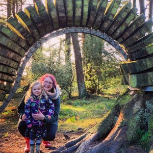 Forest walks in Lancashire with kids: Me and Spike in front of a sculpture on the Pendle Sculpture Trail in Barley
