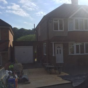 Builders building construction project Loft conversion and  garage extension at Chestnut Grove, New Malden KT3 3JJ