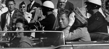 President John F. Kennedy is seen riding in motorcade approximately one minute before he was shot in Dallas, Tx., on Nov. 22, 1963. In the car riding with Kennedy are Mrs. Jacqueline Kennedy, right, Nellie Connally, left, and her husband, Gov. John Connally of Texas. (photo: AP)