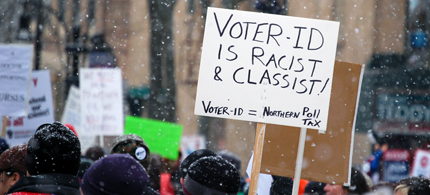 Protesters march in Wisconsin against voter ID laws. (photo: Capital Times)