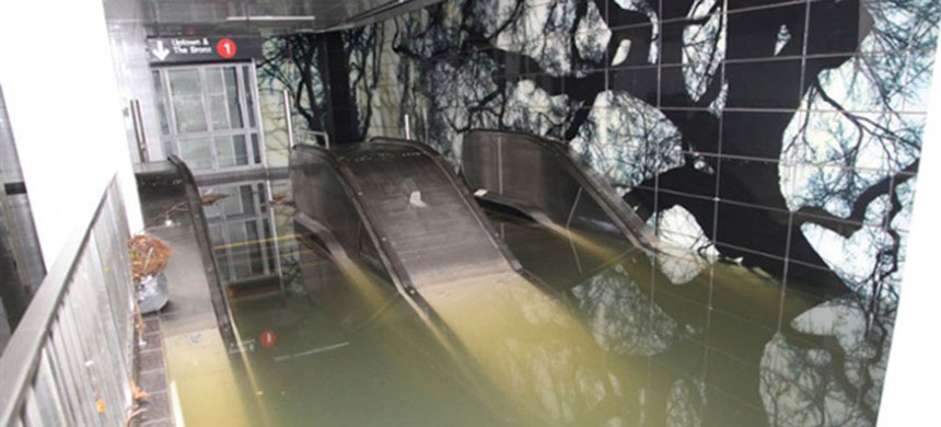 Escalators to the South Ferry Whitehall St. subway station in the financial district of Manhattan are shown flooded in the aftermath of Hurricane Sandy. (photo: Reuters)