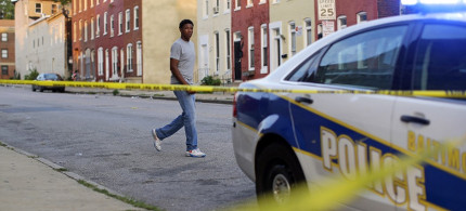 Baltimore police car at crime scene. (photo: Patrick Semansky/AP)