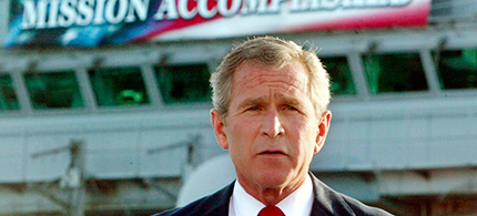 U.S. president George W. Bush declares an end to major combat in Iraq during a speech to crew aboard the aircraft carrier USS Abraham Lincoln. (photo: Larry Downing/Reuters)