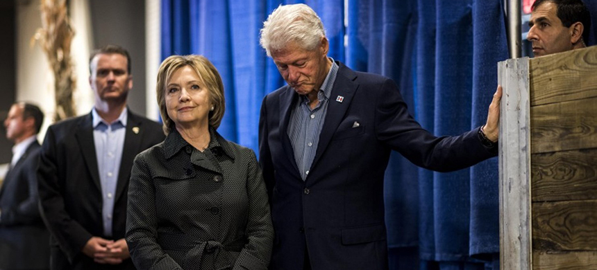 Former secretary of state Hillary Clinton and her husband former president Bill Clinton wait to go on stage at the Story County Democratic Picnic in Ames, Iowa, November 15, 2015. (photo: Melina Mara/WP)
