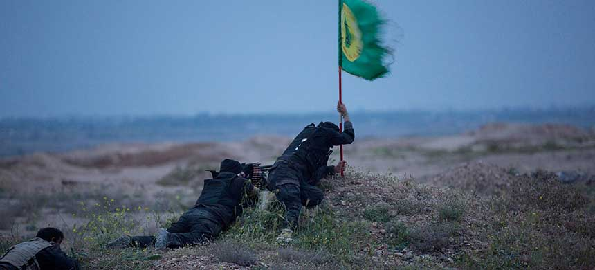 THE FIGHT: Shi'ite fighters battling Islamic State militants in northern Tikrit in March claim a patch of ground. The Shi'ite militias, backed by Iran and under the nominal control of Baghdad, have been pivotal in the fight against Islamic State. (photo: Stringer/Reuters)