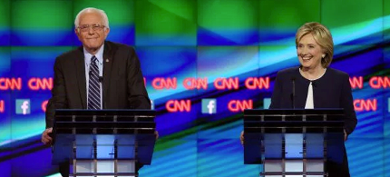 Democratic presidential candidates Senator Bernie Sanders and Hillary Clinton take part in a presidential debate. (photo: Joe Raedle/Getty Images)