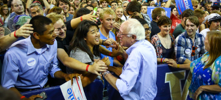Bernie Sanders shakes hands with supporters during a rally at Hec Ed Pavilion that drew an estimated 15,000 people to the University of Washington. The rally filled the arena and left thousands outside. (photo: Joshua Trujillo/seattlepi.com)