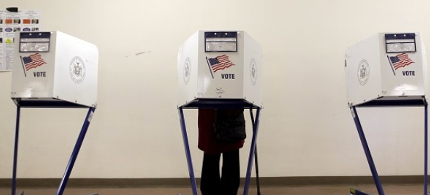 A voter is seen at a polling station during the New York primary elections in the Manhattan borough of New York. (photo: Reuters)