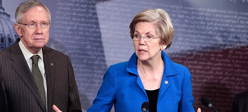 Sen Harry Reid and Sen. Elizabeth Warren. (photo: Greg Nash/Getty)