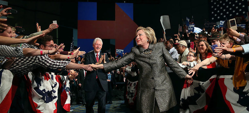 Democratic presidential candidate Hillary Clinton and former U.S. president Bill Clinton greet supporters during a primary night gathering on April 26, in Philadelphia. (photo: Justin Sullivan/Getty Images)