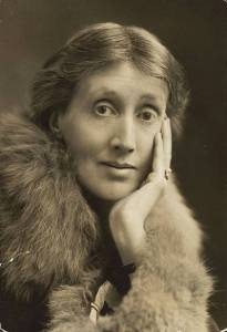 Photo of Virginia Woolf, leaning on one hand wearing a fur stole.