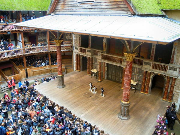 Photo looking down on stage of re-created Globe Theatre in London.
