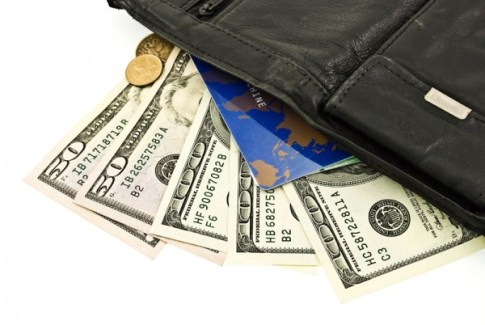 Leather purse with money and credit cards