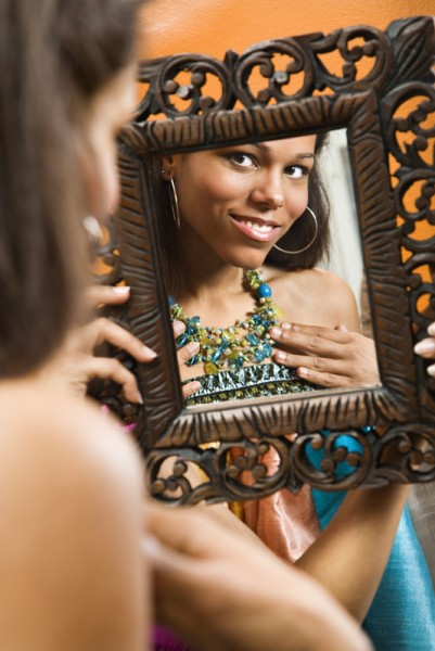 Woman in mirror.