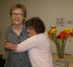 Board member hug at READ Surrey White Rock