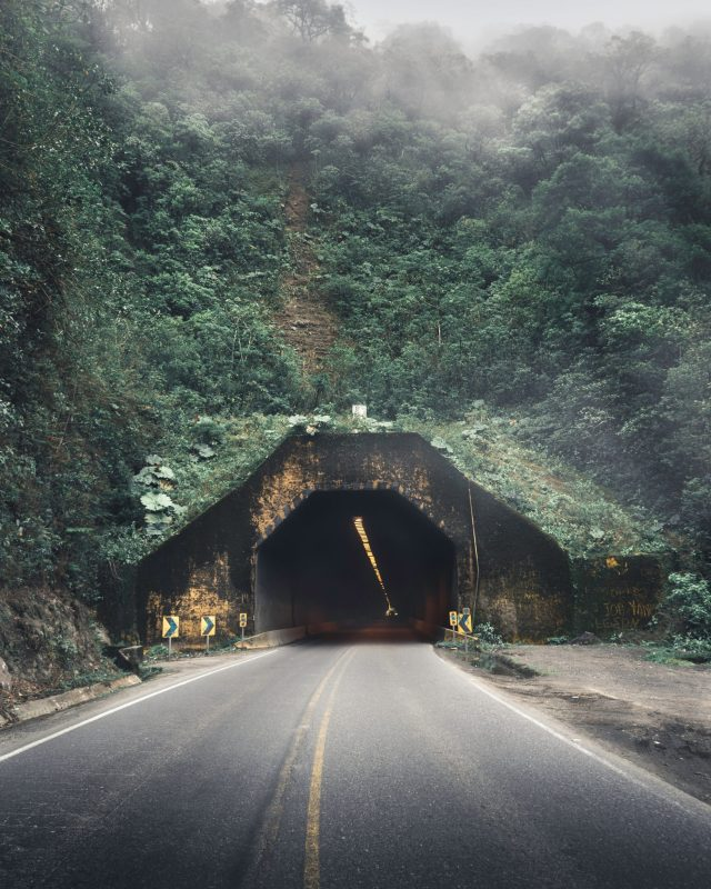 growth mindset. The entry of a tunnel, with fogs and wild nature around. How to accept and tolerate uncertainty
