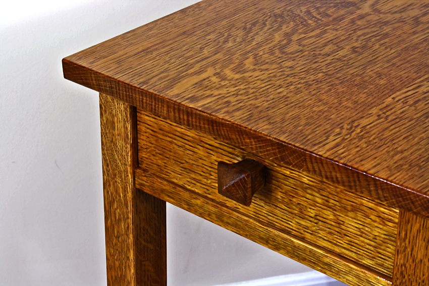 Fancy This solid quartersawn white oak table is a reproduction of a Gustav Stickley splayed leg side table the legs angle from front to back