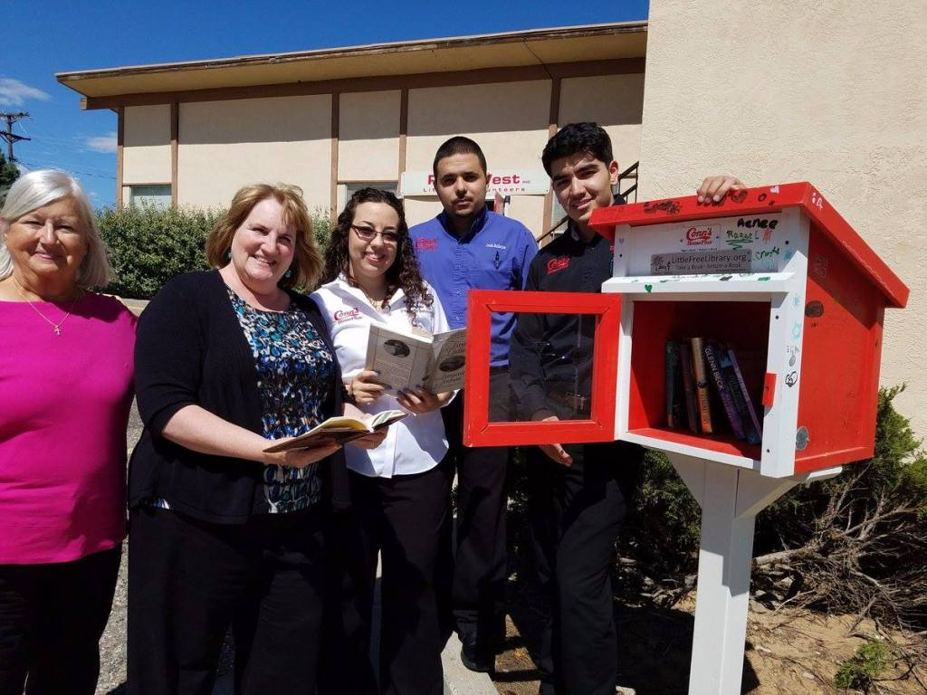 ReadWest Staff and Volunteers in front of building opening their Little Library